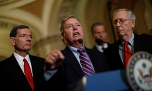 Senator Lindsey Graham, flanked by senators John Barrasso and Mitch McConnell, speaks with reporters on Capitol Hill on Tuesday.