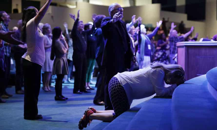 Worshippers pray at the International Church of Las Vegas before the arrival of Donald Trump during a campaign event in 2016.