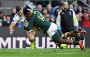 Jonny May takes a hit from South Africa's Sibusiso Nkosi.