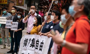 Pro-democracy supporters protest outside a police station in Hong Kong after 15 high-profile campaigners.