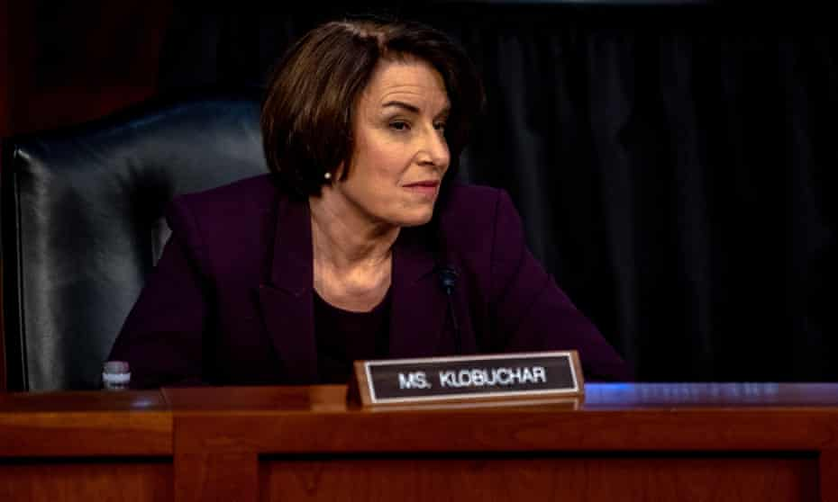 Amy Klobuchar participates in hearings for Amy Coney Barrett, then a nominee for the supreme court.