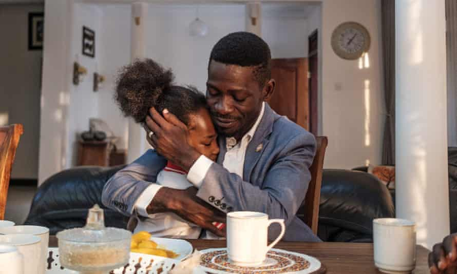 Ugandan presidential challenger Bobi Wine and his daughter Subi at his home in Kampala.