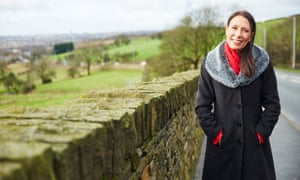 Debbie Abrahams standing outside by a stone wall