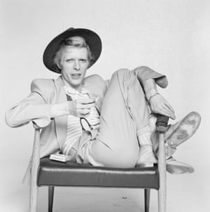 Bowie posing for a shoot by Terry O'Neill in 1974