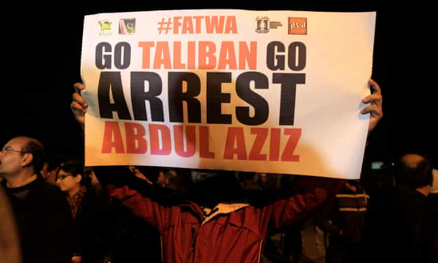 A man holds a sign during a protest near Islamabad's Red Mosque in 2014