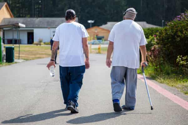 Residents walk the SCC grounds on McNeil Island.