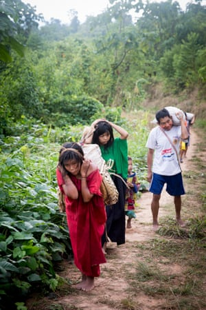 People carrying coffee and other supplies on the path to Mativaiqui, an Asháninka community on the Ene river, Peru, May 2019. Mobile traders stop off at Mativaiqui once a week to buy from locals