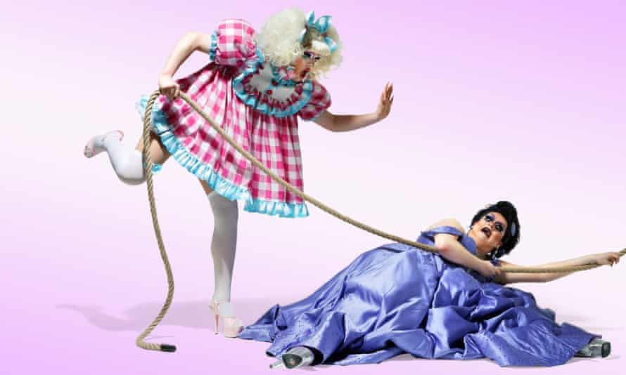 Lawrence Chaney (in purple) and Ellie Diamond (in pink), RuPaul's Drag Race Drag Queens, dressed up against a white background, 01/03/2021