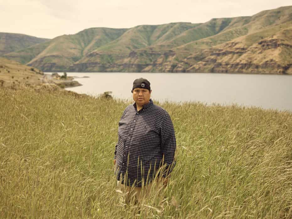 Louis Reuben photographed in front the Snake River near his ancestral homesite of Wawawai on Wednesday, May 12, 2021. Reuben's great-grandfather was born at Wawawai, which is underwater today. Lower Granite Dam flooded communities and countless other tribal sites.