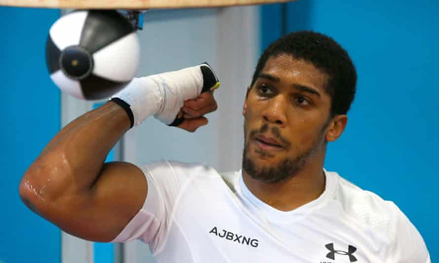 Anthony Joshua punches a punchbag