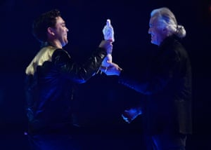 Passing the torch … Jimmy Page hands the award for best British group to Mike Kerr of Royal Blood