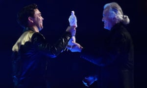 Mike Kerr of Royal Blood accepts the British Group award from Jimmy Page.