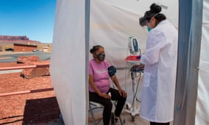 A nurse checks a woman's vitals at a Covid-19 testing site in Monument Valley, Arizona.