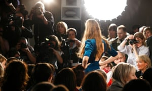 Photographers focus on a model on the catwalk during the Topshop fashion show in London in 2007.