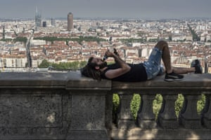 Lyon, France A man keeps cool in the shade above Lyon