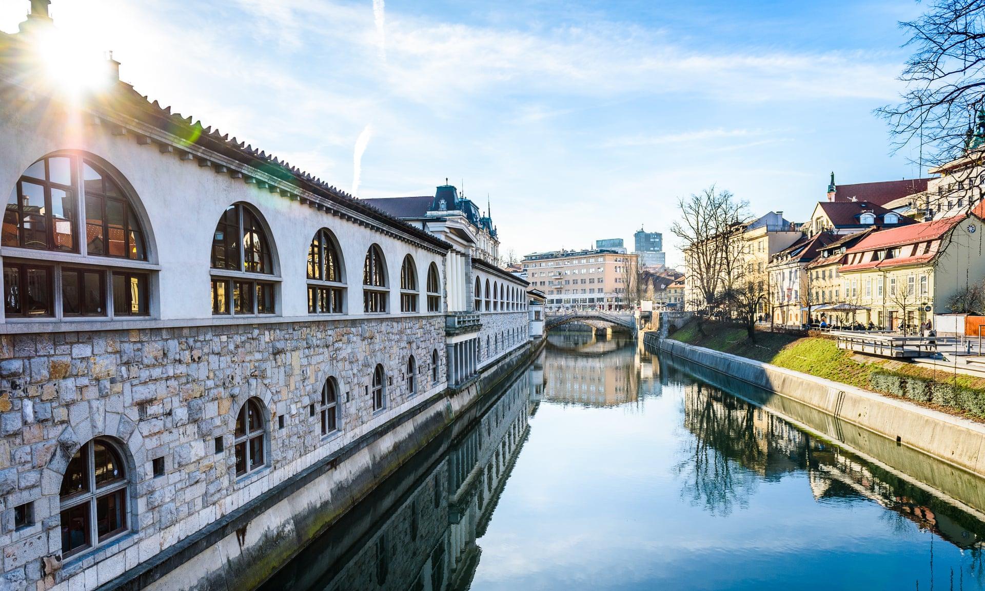 View of Ljubljanica River with old central market and Triple bridge, Ljubljana.