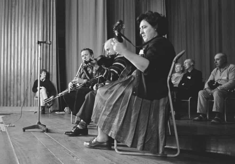Margaret Barry performs with Felix Doran and fiddler Michael Gorman at Keele folk festival, c.1965.