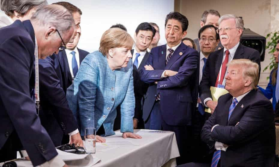 President Donald Trump with Angela Merkel and other G7 leaders during the 2018 summit in Canada.