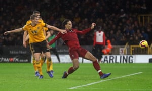 Virgil van Dijk cushions in a volley for Liverpool's second.
