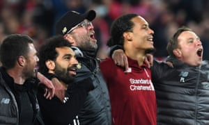 Jurgen Klopp, centre, celebrates victory against Barcelona with star players Mohamed Salah, second from left, and Virgil van Dijk, second from right.