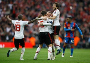 United players celebrate after the final whistle goes.