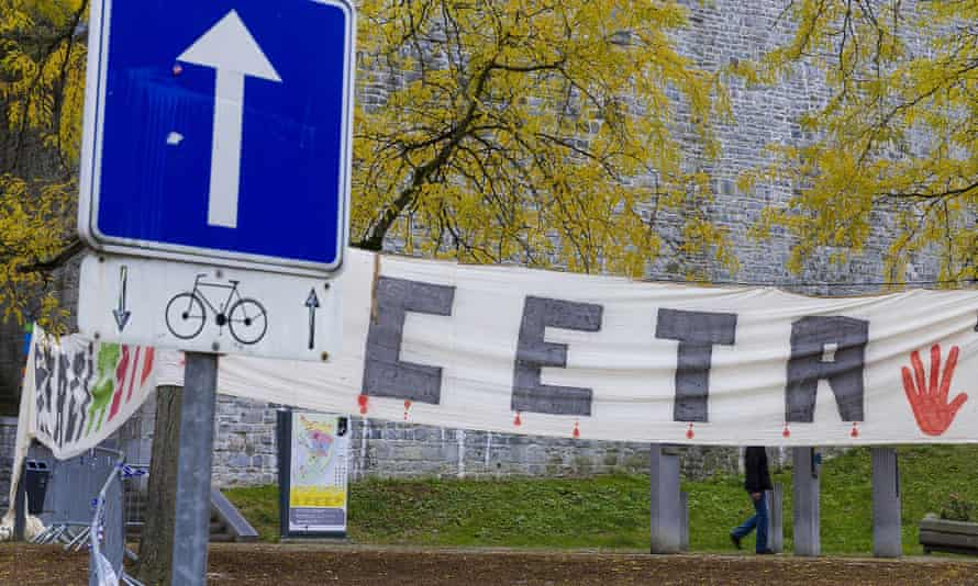 A banner protesting against the Ceta trade agreement in front of the Walloon parliament in Namur, Belgium, on 28 October