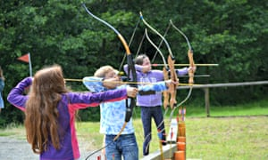 Children try out archery at the chateau near Les Chambres used as a family break destination. France.
