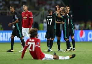 Real Madrid's Cristiano Ronaldo and Luka Modric celebrate at full-time.