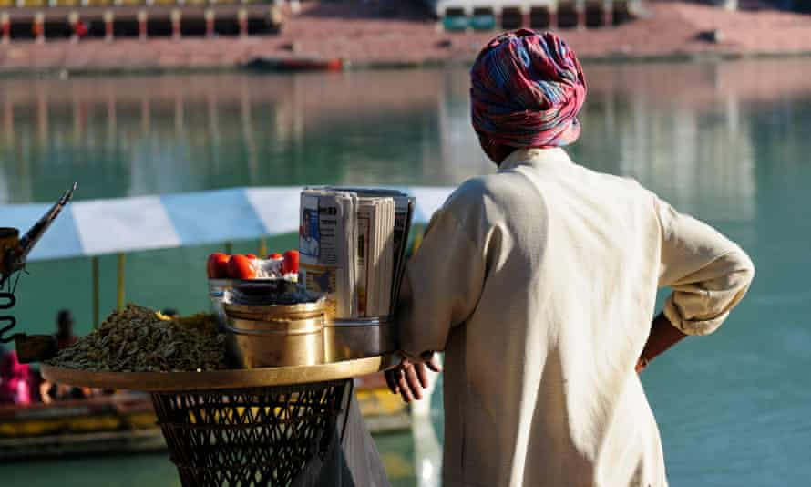 Street vendor by the river hooghly, India.