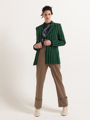 model  wears green stripe blazer, £24.99, blue paisley blouse, £14.99, and wide twill trousers, £39.99, all from hm.com. Boots, £52, office.co.uk. Ring, model's own. Bag, ikea.com.