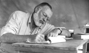 """""""Hemingway On Safari<br>American writer Ernest Hemingway (1899 - 1961) working at a portable table while on a big game hunt in Kenya, September 1952.  (Photo by Earl Theisen/Getty Images)"""""""