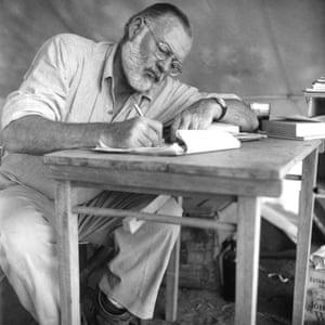 Hemingway working while on safari in 1952.