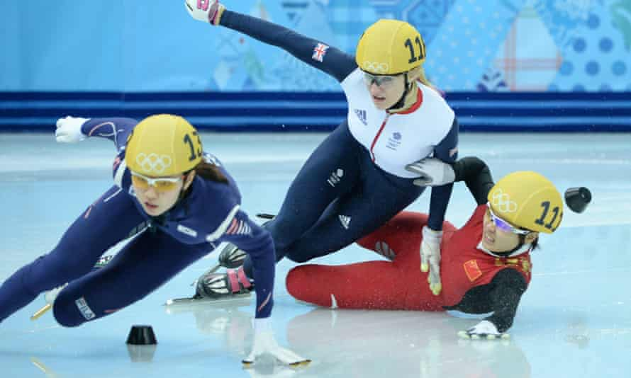 South Korea's Shim Suk-hee (left) competes in the Women's Short Track 1000 m Semifinals at the 2014 Winter Olympics.