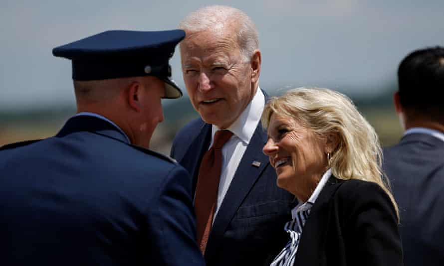Joe Biden and first lady Jill Biden are greeted as they arrive at Joint Base Andrews, Maryland on Friday.