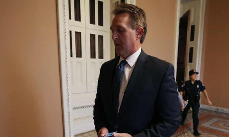 Jeff Flake walks to the Senate floor Friday in Washington DC.