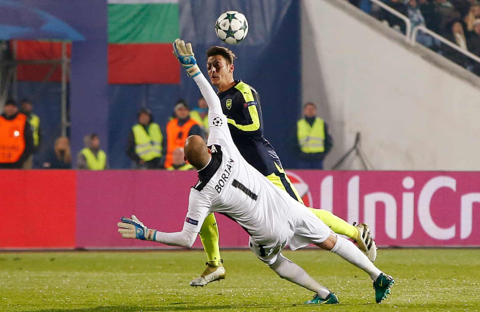 Mesut Ozil lobs goalkeeper Milan Borjan.