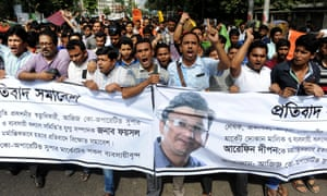 Protesters carry a banner with the image of Faisal Arefin Dipan, who was murdered in Bangladesh