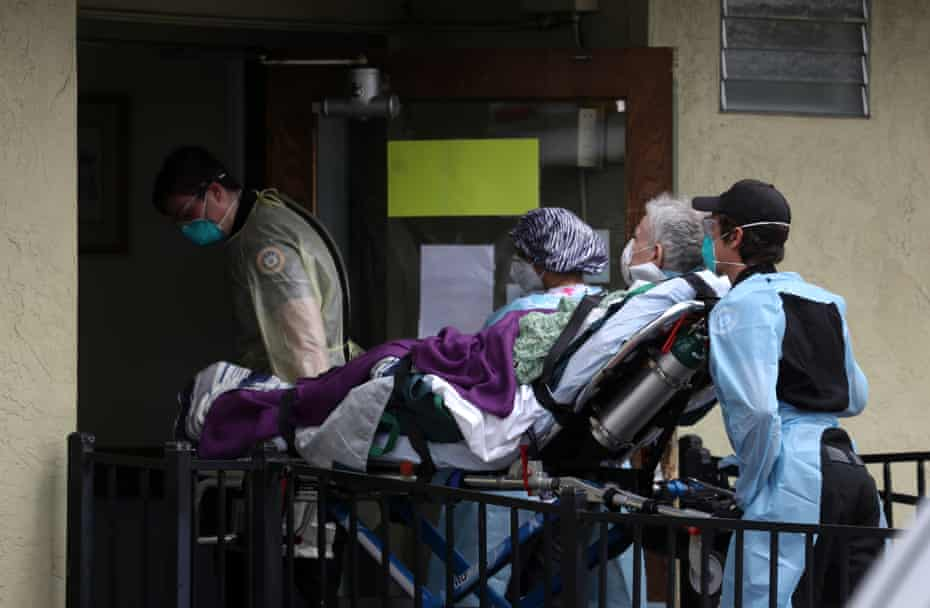 Emergency workers move a patient from Gateway to an ambulance. At least 13 Gateway residents have died from Covid-19 complications.