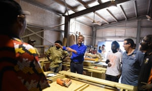 Indigenous affairs minister Nigel Scullion chats with local tradesmen and trainees in the Indigenous community of Milingimbi in the Northern Territory in July 2015 while launching government's Community Development Program.