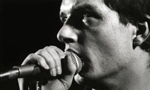 Ian Curtis performing with Joy Division.