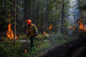 Wearing respirators against the acrid smoke, AFPS members start a controlled burn