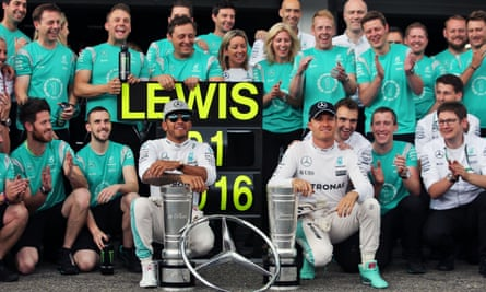 Lewis Hamilton celebrates his win in the German Grand Prix with the Mercedes team and fellow driver Nico Rosberg, who was fourth