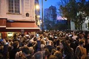 Citizens witness a fire at Notre-Dame de Paris