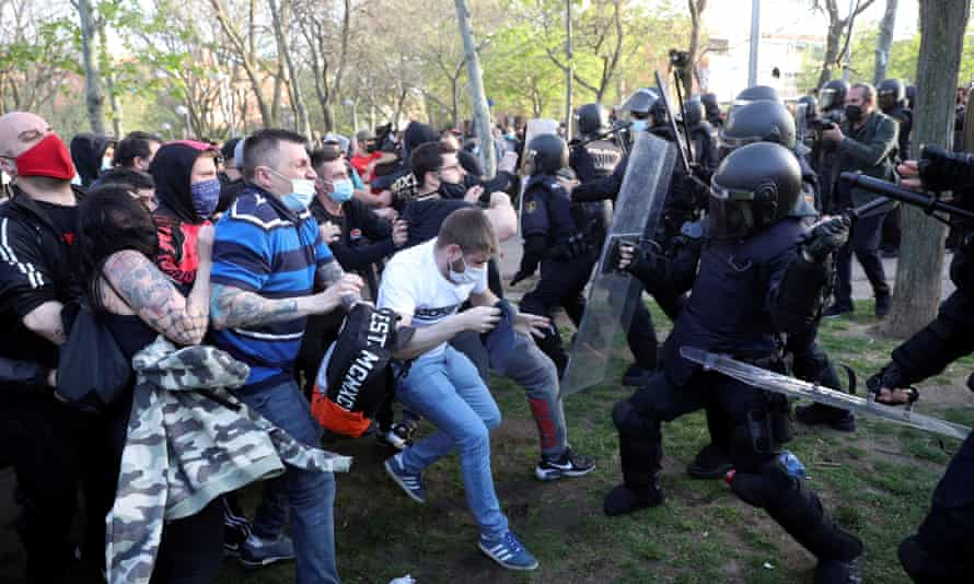 Police clash with protesters during a Vox campaign rally in Vallecas