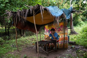When the signal fades, Andal picks up his plastic chair to move to another spot, and if it rains, he holds the phone in one hand and an umbrella in the other. Andal says he has no choice. 'We're not rich, and finishing school is my only way to repay my parents for raising me.'