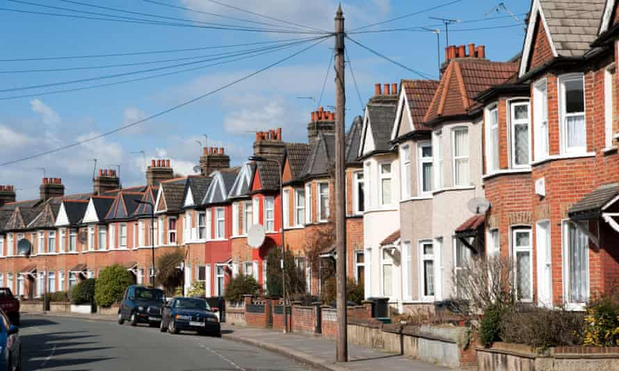 Row of terraced houses in residential Street, London, England, UK.