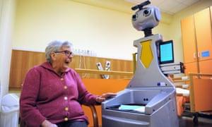 A woman at a nursing home in San Lorenzo, Italy, talks to Robot-Era