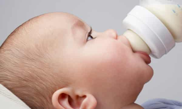 A baby being fed from a bottle