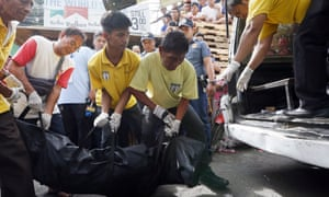 The body of man suspected of drug dealing is removed from a street in Manila after a police operation in November 2016.