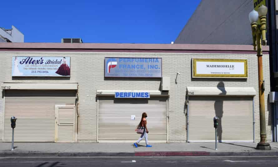 Closed shopfronts in the normally busy fashion district in Los Angeles. People in industries such as hospitality and retail have been the first to lose their jobs.